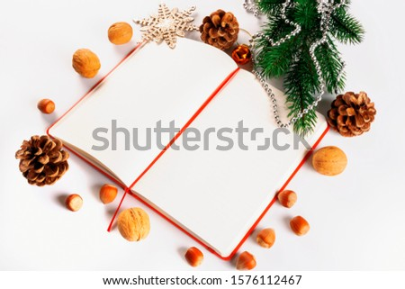 Christmas card with Christmas decorations and a diary with copy space for writing wishes #1576112467