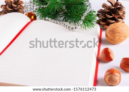 Christmas card with Christmas decorations and a diary with copy space for writing wishes #1576112473