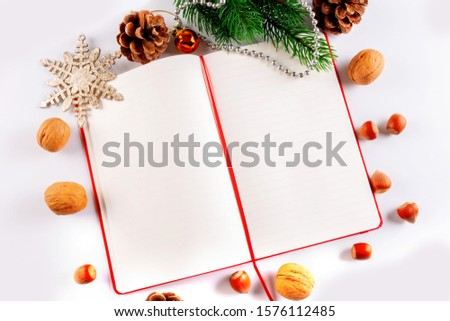 Christmas card with Christmas decorations and a diary with copy space for writing wishes #1576112485