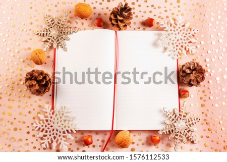 Christmas card with Christmas decorations and a diary with copy space for writing wishes #1576112533