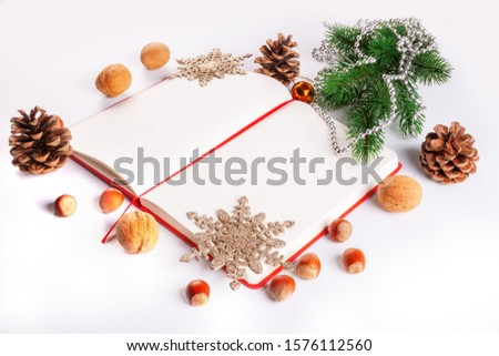 Christmas card with Christmas decorations and a diary with copy space for writing wishes #1576112560
