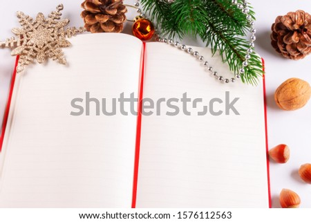 Christmas card with Christmas decorations and a diary with copy space for writing wishes #1576112563