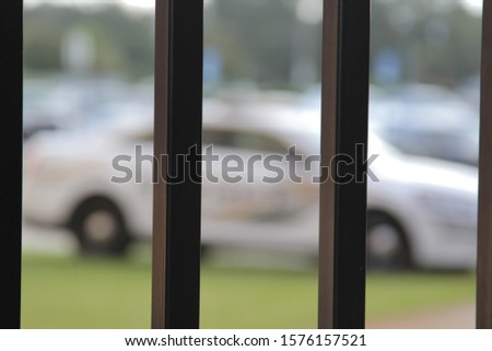 picture of cop car behind bars for any type of use.