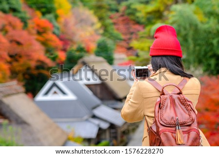 woman tourist traveler enjoy taking photo of the scenery Autumn view beside the road at Countryside, traveling in Countryside o Japan prefecture #1576228270