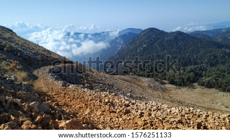 View of the countryside and the road to the mountain during the ascent of mount Takhtali in Turkey in October #1576251133