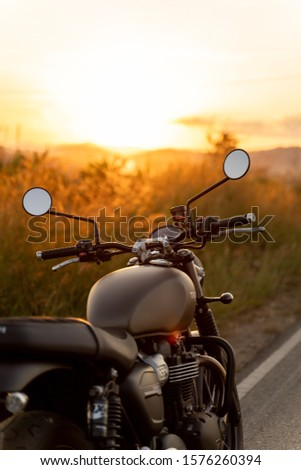 Nan Thailand. Dec 1,2019 TRIUMPH STREET TWIN900.the line at the road with sunset.on the road riding.copyspace for your individual text.  #1576260394