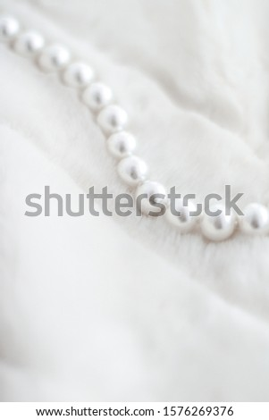Jewelry branding, elegance and sale concept - Winter holiday jewellery fashion, pearl necklace on fur background, glamour style present and chic gift for luxury jewelery brand shopping, banner design #1576269376