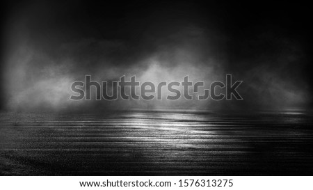 Wet asphalt, reflection of neon lights, a searchlight, smoke. Abstract light in a dark empty street with smoke, smog. Dark background scene of empty street, night view, night city. #1576313275