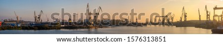 Industrial landscape. Cranes and gantries in the Szczecin shipyard. Royalty-Free Stock Photo #1576313851