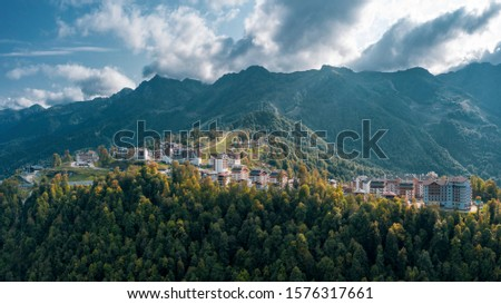 Aerial view; drone photo of hotels buildings and ski resorts of Rosa Plateau alpine mountain olympic village; beautiful summer landscape, mounts and valleys terrain; popular touristic route #1576317661