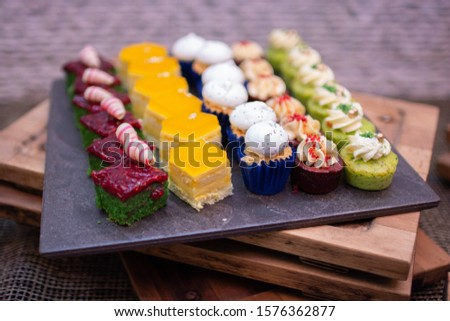 Assorted sweet french pastries. Colorful desserts and cup cakes #1576362877