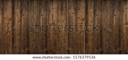 Brown wood texture. Abstract background, empty template. rustic weathered barn wood background with knots and nail holes. Close up of wall made of wooden planks. Grunge surface #1576379536