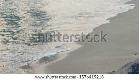 Sea wave on beach at sunset #1576415218