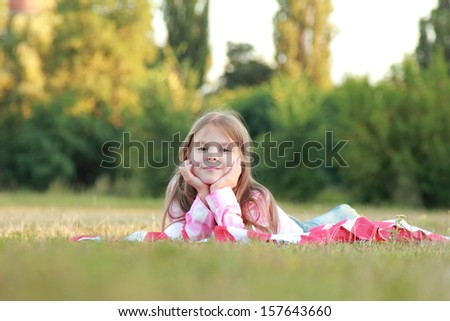 Happy adorable little girl smiling and waving American flag  #157643660