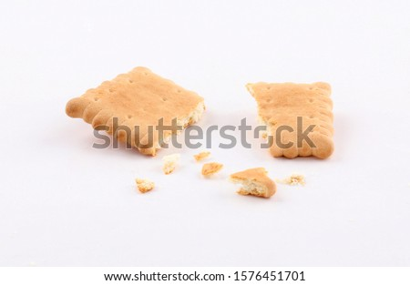 golden biscuits and sprinkled crumbs isolated on white background #1576451701