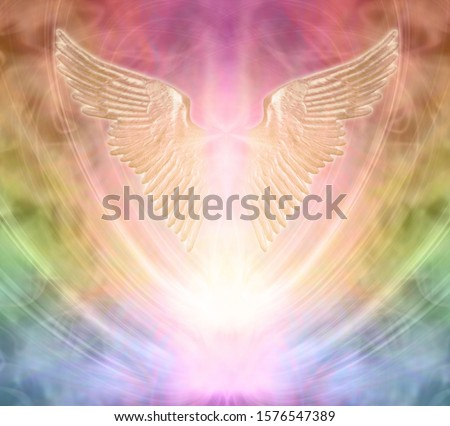 Seeking angelic help from your personal Guardian  - pair of gleaming shimmering golden angel wings against an ethereal rainbow coloured energy background  Royalty-Free Stock Photo #1576547389