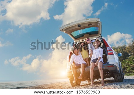 Holiday and travel family concept, Summer vacations . Happy family enjoying road trip with their favorite car. Parents and children are traveling the way to the sea or ocean or river. Royalty-Free Stock Photo #1576559980