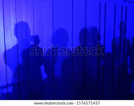 People blue silhouttes on party #1576571437