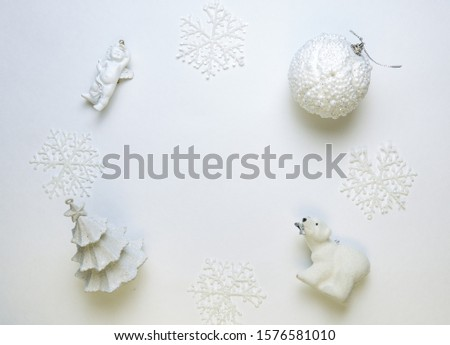 Christmas background or post card with white christmas tree,christmas ball,decorative angel,decorative polar bear and snowflakes on white background.Top view. #1576581010