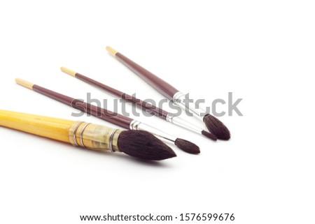 set of round artistic paintbrushes isolated on white background. Artist many paintbrushes. #1576599676
