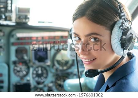 Pilot and Stewardess. Female pilot smiles and wishes a successful flight. Avia company persons crew pilots stewardess airplane command civil aviation. Pretty Stewardess Royalty-Free Stock Photo #1576601002