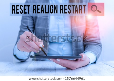 Writing note showing Reset Realign Restart. Business photo showcasing Life audit will help you put things in perspectives Business woman sitting with mobile phone and pen in the hand. #1576644961