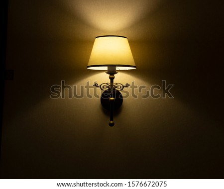 sconces wall lamp twilight dark room interior wall indoor background with soft yellow symmetry light reflection atmospheric silent picture