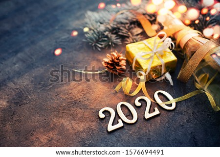 happy new year 2020 background with champagne in dark color with bokeh Royalty-Free Stock Photo #1576694491
