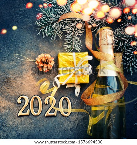 happy new year 2020 background with champagne in dark color with bokeh #1576694500