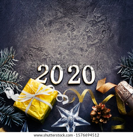happy new year 2020 background with champagne in dark color with bokeh #1576694512