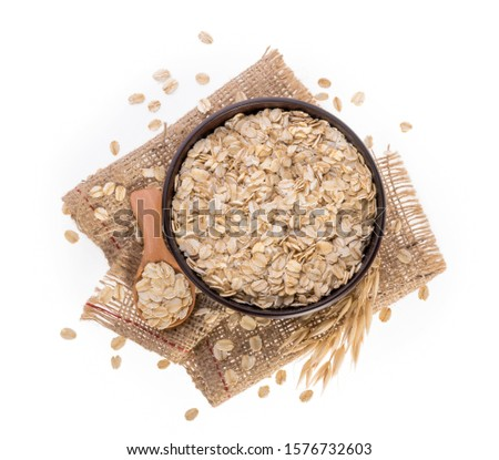 Rolled oats, healthy breakfast cereal oat flakes isolated on white top view #1576732603