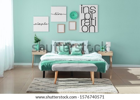 Stylish interior of bedroom in turquoise color Royalty-Free Stock Photo #1576740571