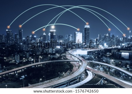 Night cityscape skyscrapers with connected line network, business partner connect concept. #1576742650