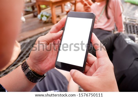 Mockup picture of business woman's hands/man's hands holding smart phone with white blank screen in modern place. #1576750111