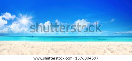 Beautiful beach with white sand, turquoise ocean water and blue sky with clouds in sunny day. Panoramic view. Natural background for summer vacation #1576804597