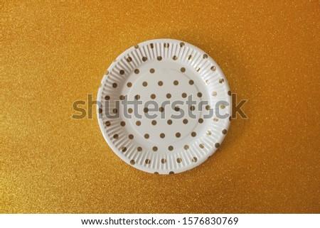gold polka dot plate for birthday celebration