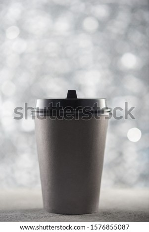 Paper cup of coffee, festive Christmas background, beautiful blurred bokeh, place for text logo #1576855087