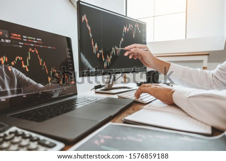 Investment stock market Entrepreneur Business team discussing and analysis graph stock market trading,stock chart concept #1576859188