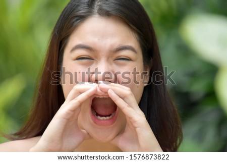 A Pretty Minority Female Yelling #1576873822
