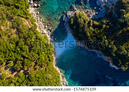 Aerial of a hidden beach on Corfu island. Limni secluded mediterranean beach in Greece #1576875109