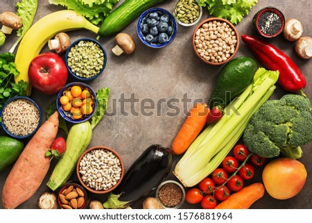 Fresh fruits, vegetables, cereals, legumes, seeds and berries. Organic food for vegans and vegetarians, frame. Healthy detox nutrition concept. Top view, copy space #1576881964