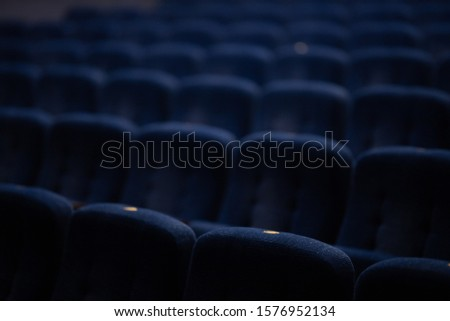 Blue soft velvet chairs in the theater hall #1576952134