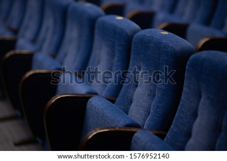 Blue soft velvet chairs in the theater hall #1576952140