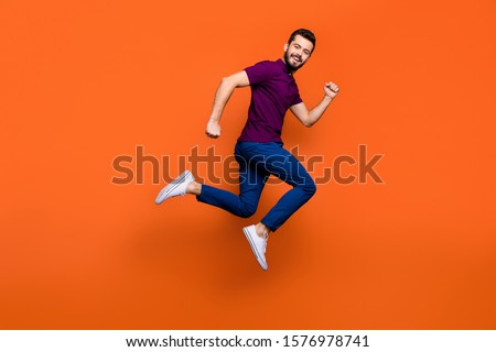 Side profile full length body size photo of crazy cheerful jumping running man in white sneakers aspiring to come for sales on time isolated vivid color background #1576978741