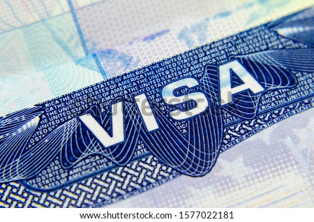 US Visa sticker in a passport. Allows you to enter the United States of America. Business  Royalty-Free Stock Photo #1577022181