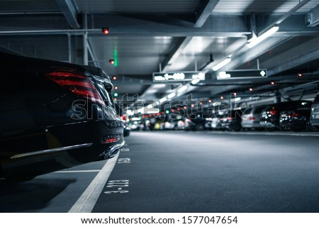 Underground garage or modern car parking with lots of vehicles #1577047654