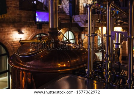 Craft beer production line in private microbrewery Royalty-Free Stock Photo #1577062972