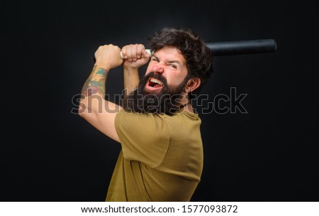 Baseball player with baseball bat. Angry man in t-shirt ready to swing. Sports and baseball training. Sport equipment. Sport, training, health. Power and energy concept. Bearded man with baseball bat. #1577093872