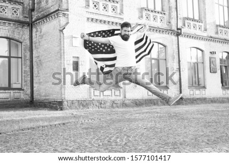 Join celebration. Patriotic guy expressing happiness in street. Patriotic spirit. Patriotic man jumping with american flag. Independence day. Bearded hipster patriotic citizen. Happy and proud. #1577101417