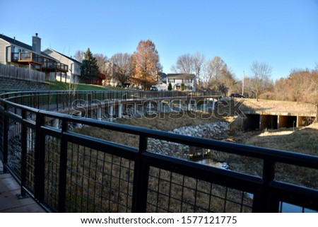The railing of a boardwalk in St. Peters, Missouri. Picture taken outside on a fall day in November.